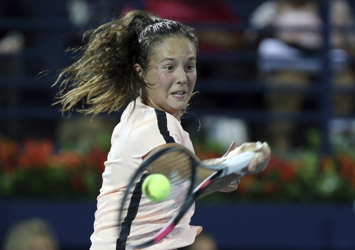 Daria Kasatkina of Russia returns a ball to Elina Svitolina of Ukraine at the final match of the Dubai Duty Free Tennis Championship in Dubai, United Arab Emirates, Saturday, Feb. 24, 2018. (AP Photo/Kamran Jebreili)