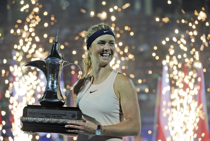 Elina Svitolina of Ukraine holds the trophy after she beats Daria Kasatkina of Russia at the final match of the Dubai Duty Free Tennis Championship in Dubai, United Arab Emirates, Saturday, Feb. 24, 2018. (AP Photo/Kamran Jebreili)