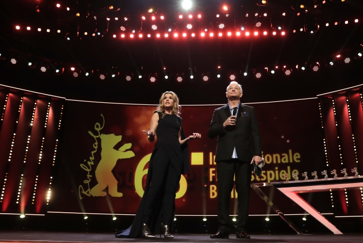 US actor Bill Murray and host Anke Engelke, left, stand on the stage during the awarding ceremony of the 68th edition of the International Film Festival Berlin, Berlinale, in Berlin, Germany, Saturday, Feb. 24, 2018. (AP Photo/Markus Schreiber)