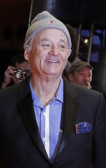 US actor Bill Murray wears a hat with a Berlinale logo on the red carpet for the awarding ceremony of the 68th edition of the International Film Festival Berlin, Berlinale, in Berlin, Germany, Saturday, Feb. 24, 2018. (AP Photo/Markus Schreiber)