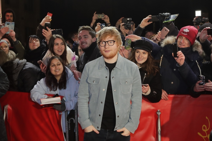Singer-songwriter Ed Sheeran, center, arrives for the screening of the film 'Songwriter' during the 68th edition of the International Film Festival Berlin, Berlinale, in Berlin, Germany, Friday, Feb. 23, 2018. (AP Photo/Markus Schreiber)