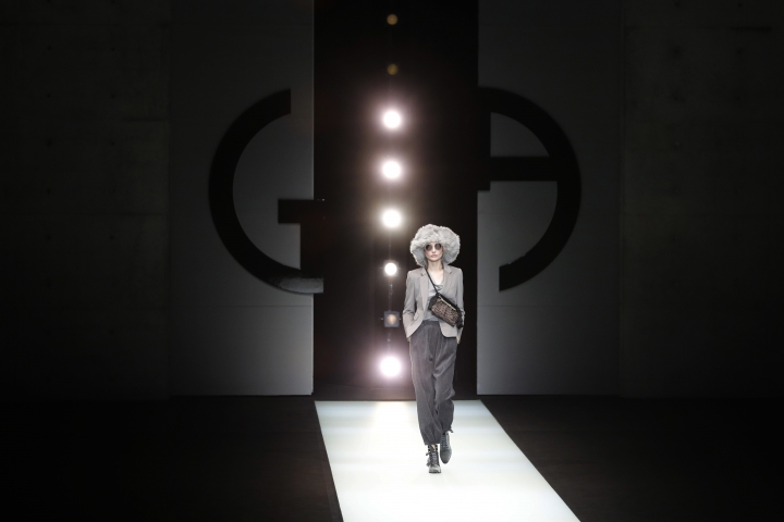 A model wears a creation as part of the Armani women's Fall/Winter 2018-2019 collection, presented during the Milan Fashion Week, in Milan, Italy, Saturday, Feb. 24, 2018. (AP Photo/Antonio Calanni)