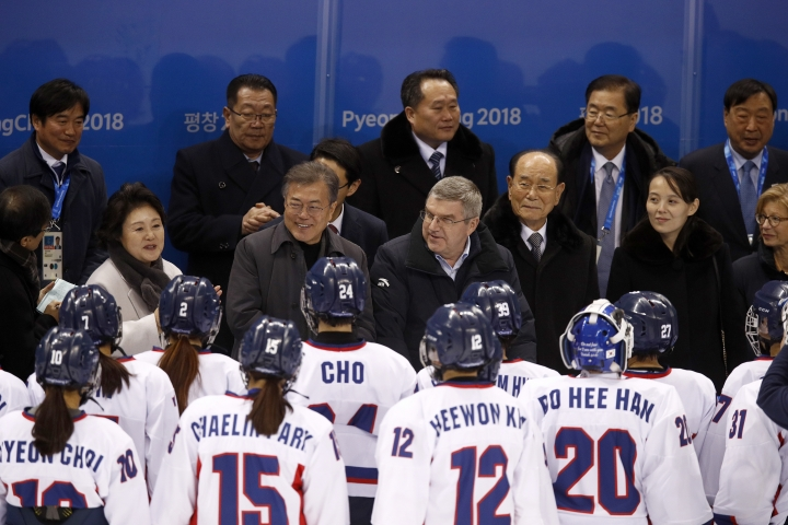 The first lady first lady Kim Jung-sook, left, South Korean President Moon Jae-in, IOC president Thomas Bach, North Korea's nominal head of state Kim Yong Nam and Kim Yo Jong, sister of North Korean leader Kim Jong Un, greet players after the preliminary round of the women's hockey game between Switzerland and the combined Koreas at the 2018 Winter Olympics in Gangneung, South Korea, Saturday, Feb. 10, 2018. (AP Photo/Jae C. Hong)