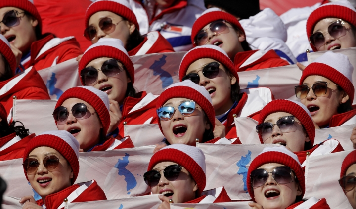 North Korean cheerleaders perform during the first run of the women's slalom at the 2018 Winter Olympics in Pyeongchang, South Korea, Friday, Feb. 16, 2018. (AP Photo/Charlie Riedel)