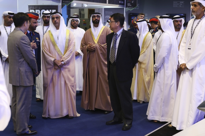 Emirati Interior Minister Sheikh Saif bin Zayed Al Nahyan, left, and Emirati Minister of State for Defense Mohammed bin Ahmed al-Bowardi speak to Chinese officials at a drone conference in Abu Dhabi, United Arab Emirates, Sunday, Feb. 25, 2018. The United Arab Emirates on Sunday opened a stand-alone trade show featuring military drones called the Unmanned Systems Exhibition & Conference, showing the power the weapons have across the Middle East. (AP Photo/Jon Gambrell)