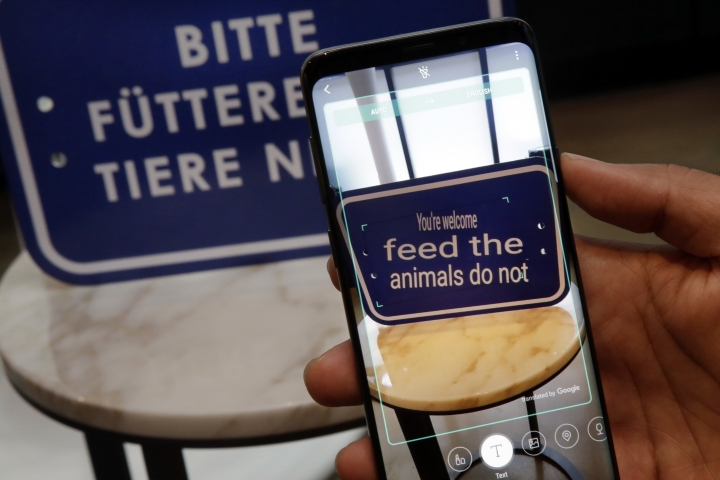 In this Feb. 21, 2018, photo, the Bixby virtual assistant software of a Samsung Galaxy S9 Plus mobile phone translates a foreign language sign during a product preview in New York. The Galaxy S9 phones were unveiled Sunday, Feb. 25, in Barcelona, Spain, and will be available March 16. Advance orders begin this Friday. (AP Photo/Richard Drew)