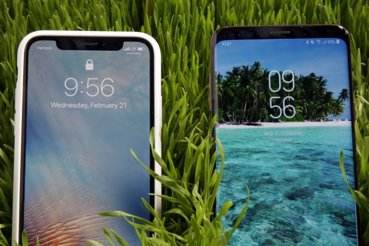 This Wednesday, Feb. 21, 2018, photo shows an Apple iPhone X, left, and a Samsung Galaxy S9 Plus mobile phone during a preview in New York. The Galaxy S9 phones were unveiled Sunday, Feb. 25, in Barcelona, Spain, and will be available March 16. Advance orders begin this Friday. (AP Photo/Richard Drew)