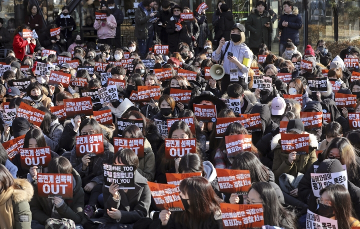 """In this Feb. 25, 2018, photo, the crowd stage a rally supporting the MeToo movement in Seoul, South Korea. President Moon Jae-in said in a meeting with his advisers Monday, Feb. 26, 2018, that he expressed respect to the victims who spoke up against some of South Korea's most powerful men for their sexual misconduct and urged authorities to investigate the cases thoroughly, according to his office's website. The signs read: """" Sexual abuse of performances"""", """"We support victims' courageous revelations"""". (Park Jin-hee/Newsis via AP)"""