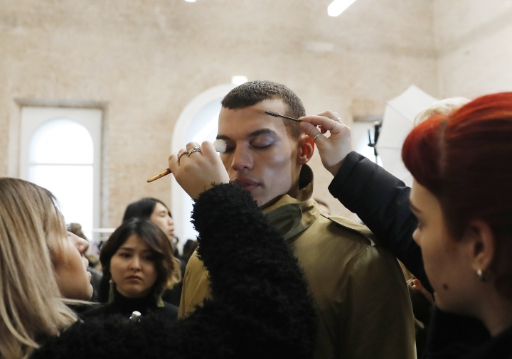 A model is made up prior to the Atsushi Nakashima women's Fall/Winter 2018-2019 collection, presented during the Milan Fashion Week, in Milan, Italy, Monday, Feb. 26, 2018. (AP Photo/Antonio Calanni)