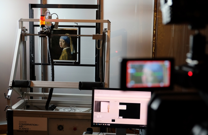 "A Macro XRF scanner is used to study in minute detail the surface of Johannes Vermeer's masterpiece ""Girl with a Pearl Earring"", at the Mauritshuis museum in The Hague, Netherlands, Monday, Feb. 26, 2018. Researchers at the Mauritshuis museum are using the latest technology to take a long, hard look at one of their most prized paintings, Johannes Vermeer's ""Girl with a Pearl Earring,"" and they are letting the public in to watch. For two weeks, experts are pointing a battery of high-tech machines at the 17th century masterpiece of a young woman whose enigmatic gaze has earned her the nickname of the Dutch Mona Lisa. (AP Photo/Mike Corder)"