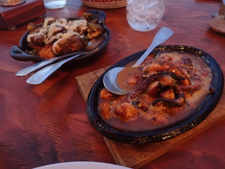 This Oct. 15, 2017 photo shows dishes, baked brussels sprouts and grilled octopus, right, at Finca Altozano in Valle de Guadalupe in Ensenada Municipality, Baja California, Mexico. (AP Photo/Nicole Evatt)