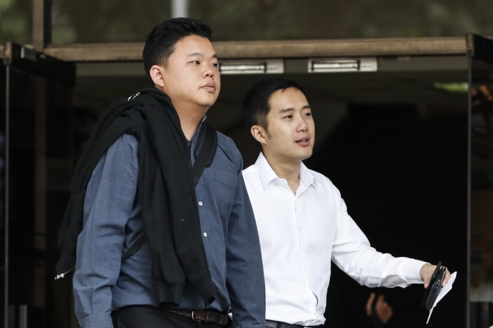 FILE - In this Tuesday, Jan. 16, 2018, file photo, Yao Songliang, left, and Terence Tan En Wei, leave the State Court after their hearing on charges of providing short-term rentals to tenants via Airbnb in Singapore. The two men have pleaded guilty Tuesday to using platforms including Airbnb to rent out condominium units for less than six months in Singapore, where short-term rentals are illegal. (AP Photo/Yong Teck Lim, File)