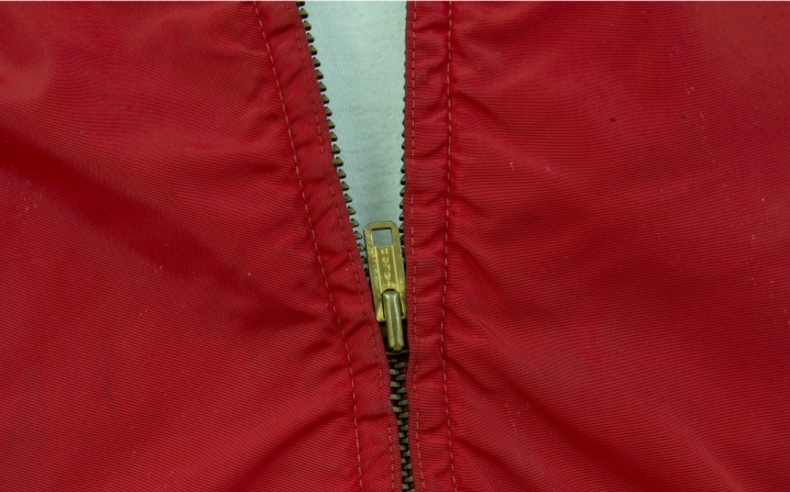 """In this, Monday, Feb. 12, 2018, photo, the zipper on a jacket worn by actor James Dean in the film """"Rebel Without a Cause,"""" is viewed at Palm Beach Modern Auctions in West Palm Beach, Fla. The jacket, privately owned since Dean wore it in the 1955 film, will be publicly auctioned in Florida on March 3. (AP Photo/Wilfredo Lee)"""