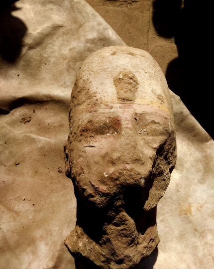 This photo released by the Egyptian Ministry of Antiquities, shows the head of a statue of one of the most famous pharaohs, Ramses II, that was discovered along with other parts of a statue in the Temple of Kom Ombo, in Aswan, 585 miles (940 kilometers) south of Cairo, Egypt, Tuesday, Feb. 27, 2018. The statement said the discovery was made during a project to protect the site from groundwater. (Egyptian Ministry of Antiquities via AP)