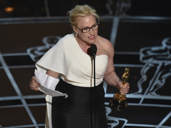 """FILE - In this Feb. 22, 2015, file photo, Patricia Arquette accepts the Oscar for best actress in a supporting role for """"Boyhood"""" in Los Angeles. In her acceptance speech, Arquette took aim at the wage gap and gender equality. (Photo by John Shearer/Invision/AP, File)"""
