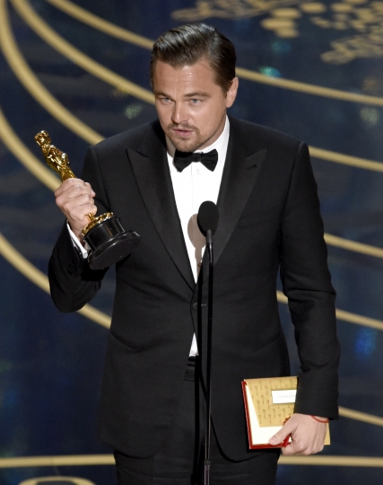 "FILe - In this Feb. 28, 2016 file photo, Leonardo DiCaprio talks about climate change as he accepts the award for best actor in a leading role for ""The Revenant"" at the Oscars in Los Angeles. (Photo by Chris Pizzello/Invision/AP, File)"