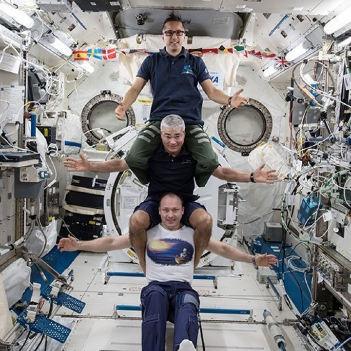 This image provided by NASA on Feb. 25, 2018, shows from bottom to top: Russia's Alexander Misurkin, NASA's Mark Vande Hei, middle, and NASA's Joe Acaba posing for a photograph at the International Space Station. The three astronauts are headed back to Earth on Tuesday, Feb. 27, following a nearly six-month mission at the International Space Station. Misurkin, Vande Hei and Acaba moved into the orbiting lab in September. They are targeting a Kazakhstan touchdown for their Russian capsule. (NASA via AP)