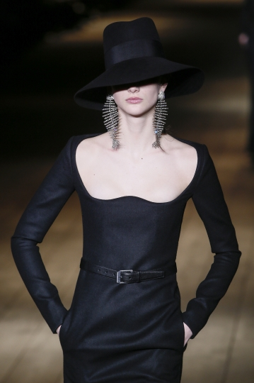 A model wears a creation for Saint Laurent's ready-to-wear fall/winter 2018/2019 fashion collection presented in Paris, Tuesday Feb.27, 2018. (AP Photo/Kamil Zihnioglu)