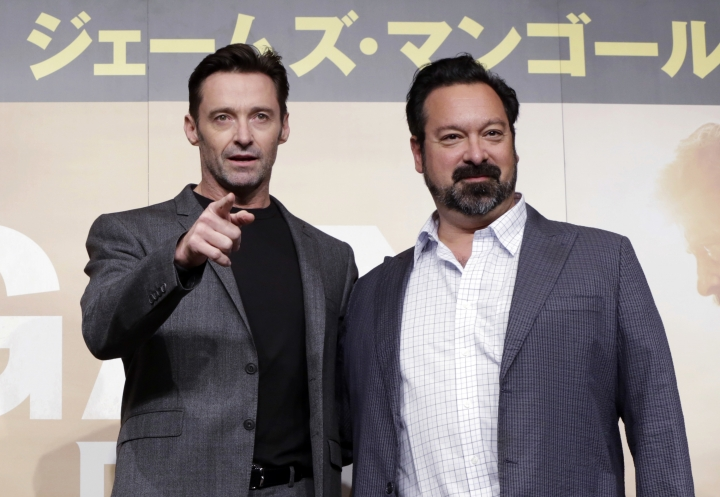 "FILE - In this May 25, 2017 file photo, actor Hugh Jackman, left, and director James Mangold pose for photographers during a press conference for their film ""Logan"" in Tokyo. Mangold, along with Michael Green and Scott Frank, is nominated for an Oscar for adapted screenplay for the film. The 90th Academy Awards will be held on Sunday, March 4. (AP Photo/Eugene Hoshiko, File)"
