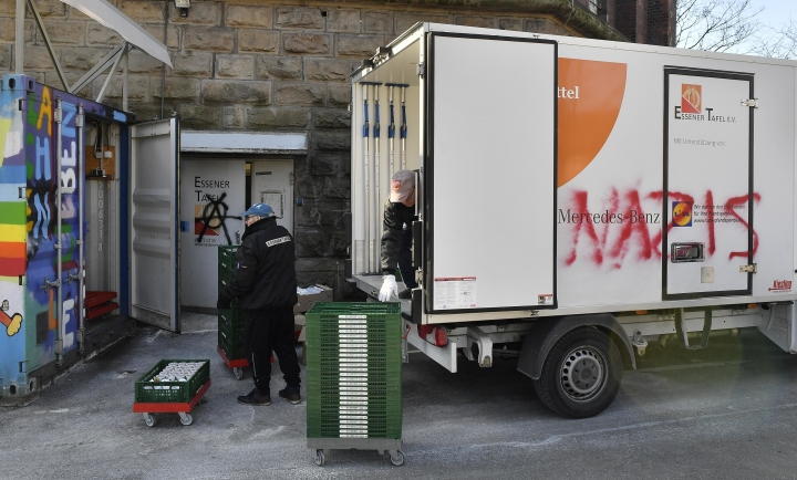 "In this Feb. 27, 2018 photo helpers unload a truck of the Essen, western Germany, food bank where unknown people sprayed ""Nazis"" onto. The food bank was criticized after deciding to only register new users if they prove they've got German citizenship, claiming young foreign men are scaring away elderly people and women. (AP Photo/Martin Meissner)"