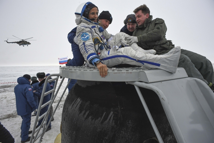 Ground personnel help NASA astronaut Joe Acaba to get out of the Soyuz MS-06 space capsule after landing in a remote area south-east of the Kazakh town of Zhezkazgan, Kazakhstan, Wednesday, Feb. 28, 2018. Three astronauts returned from the International Space Station to the snowy, bitingly cold flat lands of Central Asia, ending a 5 1/2-month mission highlighted by robotic renovations, schoolteacher pep talks and heavenly greetings from Pope Francis. (Alexander Nemenov/Pool Photo via AP)