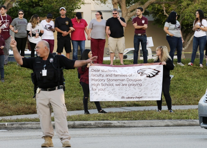 A sign of support is held up at Marjory Stoneman Douglas High School in Parkland, Fla., Wednesday, Feb. 28, 2018. Students returned to class for the first time since a former student opened fire there with an assault weapon. (AP Photo/Terry Renna)
