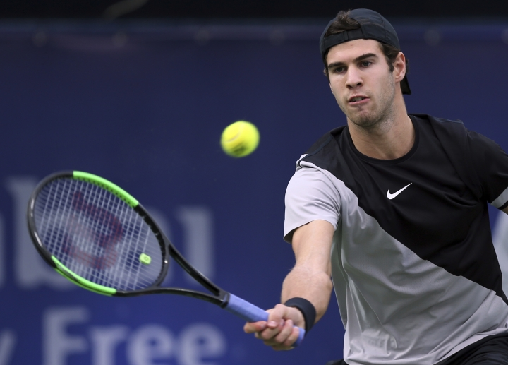 Karen Khachanov of Russia returns the ball to Lucas Pouille of France during the Dubai Duty Free Tennis Championship in Dubai, United Arab Emirates, Wednesday, Feb. 28, 2018. (AP Photo/Kamran Jebreili)