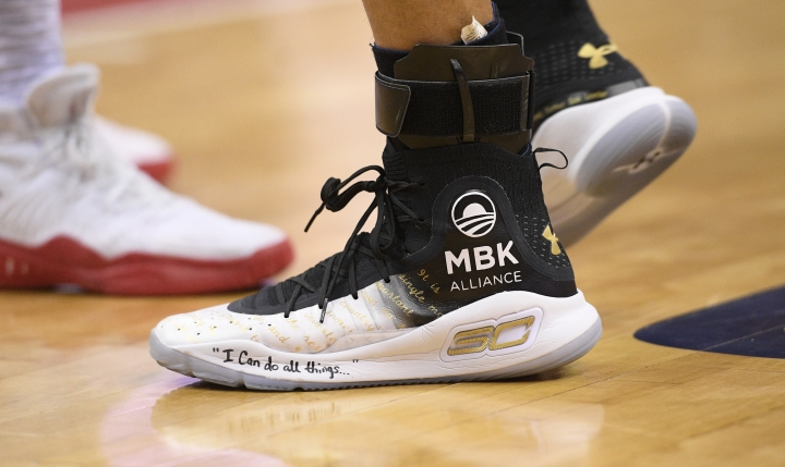 Golden State Warriors guard Stephen Curry's shoes are adorned with messages during the first half of the team's NBA basketball game against the Washington Wizards, Wednesday, Feb. 28, 2018, in Washington. (AP Photo/Nick Wass)