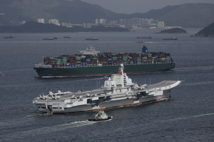 FILE - In this July 7, 2017, file photo, the Liaoning, China's first aircraft carrier, sails into Hong Kong for a port call. Chinese media reports say the country is planning to build a nuclear-powered aircraft carrier capable of remaining at sea for long durations, in what would mark a major upgrade for its increasingly formidable navy. (AP Photo/Kin Cheung, File)