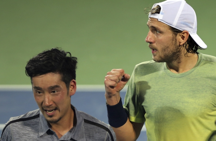 Lucas Pouille of France, right, celebrates after he beat Yuichi Sugita of Japan during the Dubai Duty Free Tennis Championship in Dubai, United Arab Emirates, Thursday, March 1, 2018. (AP Photo/Kamran Jebreili)
