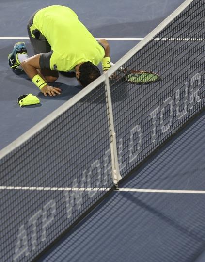 Malek Jaziri of Tunisia prays after he beats Stefanos Tsitsipas of Greece during the Dubai Duty Free Tennis Championship in Dubai, United Arab Emirates, Thursday, March 1, 2018. (AP Photo/Kamran Jebreili)