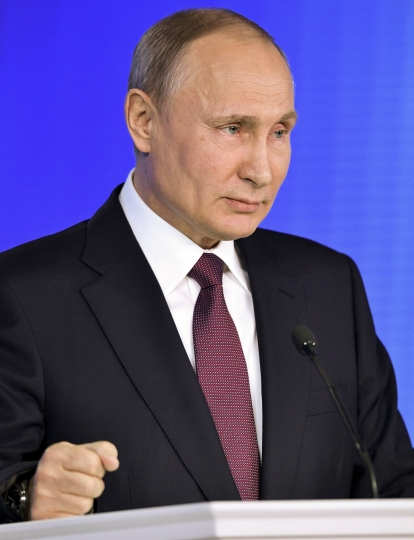 Russian President Vladimir Putin gives his annual state of the nation address in Manezh in Moscow, Russia, Thursday, March 1, 2018. Putin set a slew of ambitious economic goals, vowing to boost living standards, improve health care and education and build modern infrastructure in a state-of-the-nation address. (Alexei Nikolsky, Sputnik, Kremlin Pool Photo via AP)
