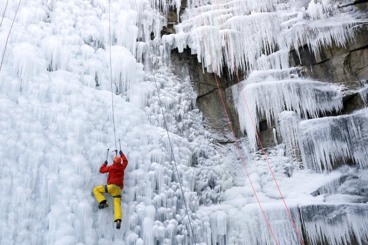 A man climbs up an artificial ice wall in Liberec, Czech Republic, Thursday, March 1, 2018. Central Europe has been hit by unusually freezing weather in recent days. (AP Photo/Petr David Josek)