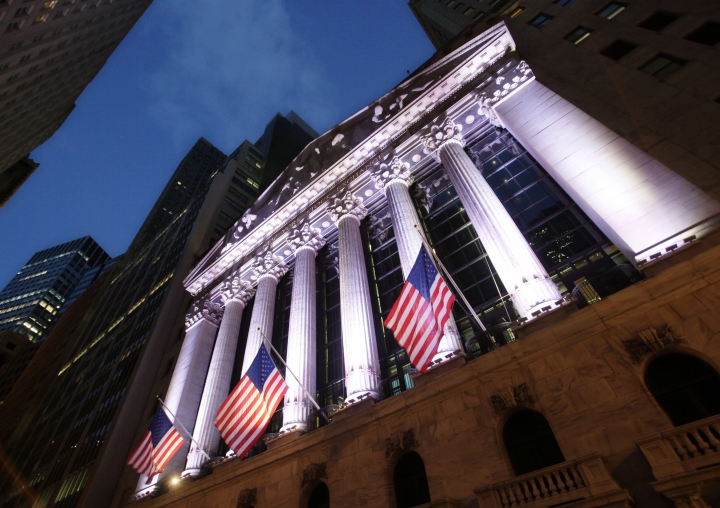 FILE - In this Oct. 8, 2014, file photo, American flags fly in front of the New York Stock Exchange. U.S. stocks sank sharply on Thursday, March 1, 2018, in another dizzying day of trading after President Donald Trump promised stiff tariffs on imported steel and aluminum, which investors feared could lead to retaliation by other countries and higher inflation. (AP Photo/Mark Lennihan, File)