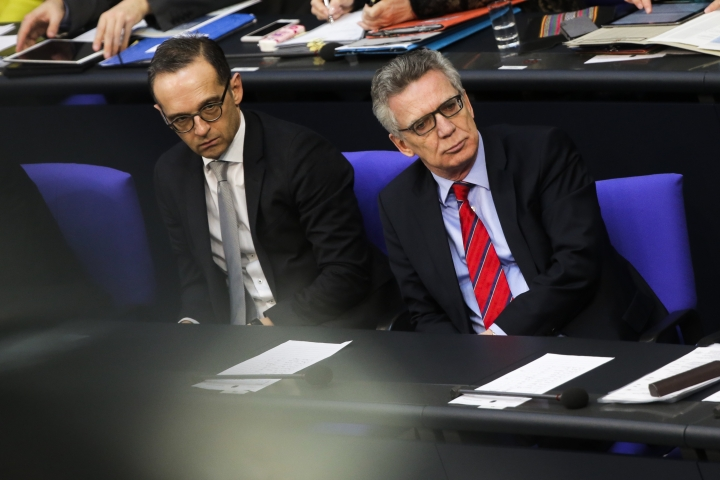 German Justice Minister Heiko Maas, left, and Interior Minister Thomas de Maiziere, right, attend a debate at Germany's parliament, the Bundestag, in Berlin, Germany, Thursday, March 1, 2018. German lawmakers have criticized the government for not informing them about a cyber attack that was able to infiltrate the government's secure computer networks last year. (AP Photo/Markus Schreiber)