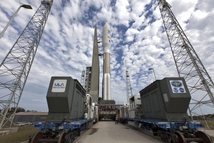 In this undated photo provided by NASA, a United Launch Alliance Atlas V rocket, waitin for liftoff on Thursday, March 1, 2018, is rolled to Space Launch Complex 41 at Cape Canaveral Air Force Station in Florida. GOES-S is the second satellite in an approximately $11 billion effort that's already revolutionizing forecasting with astonishingly fast, crisp images of hurricanes, wildfires, floods, mudslides and other natural calamities. (Ben Smegelsky/NASA via AP)