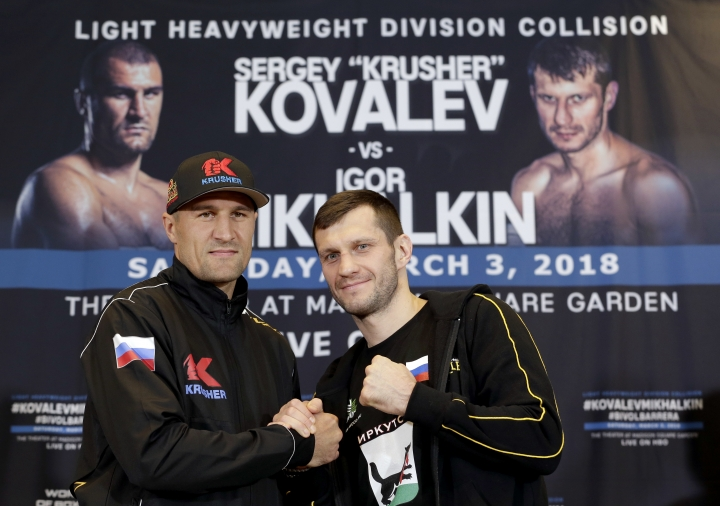 Boxers Sergey Kovalev, left, and Igor Mikhalkin pose for a picture during a news conference in New York, Wednesday, Feb. 28, 2018. The fighters will meet on March 3, 2018 at The Theater at Madison Square Garden in New York. (AP Photo/Seth Wenig)