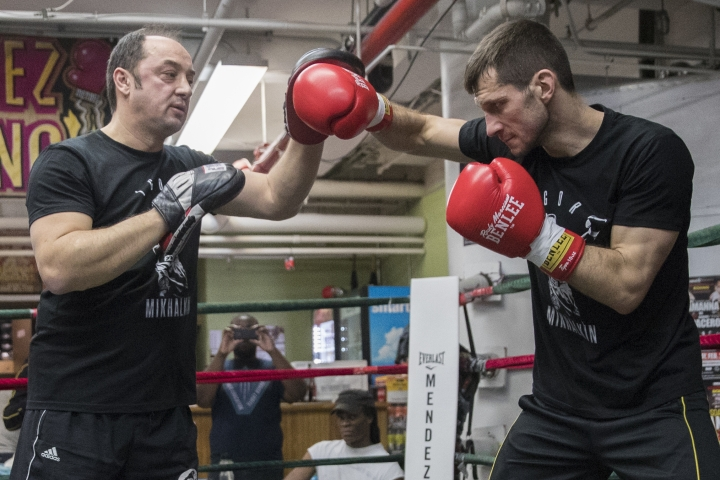 Igor Mikhalkin spars with a trainer during a media workout at Mendez Gym, Tuesday, Feb. 27, 2018, in New York. Mikhalkin is slated to fight Sergey Kovalev for Kovalev's WBO light heavyweight title on Saturday, March 3, at the Theater at Madison Square Garden. (AP Photo/Mary Altaffer)