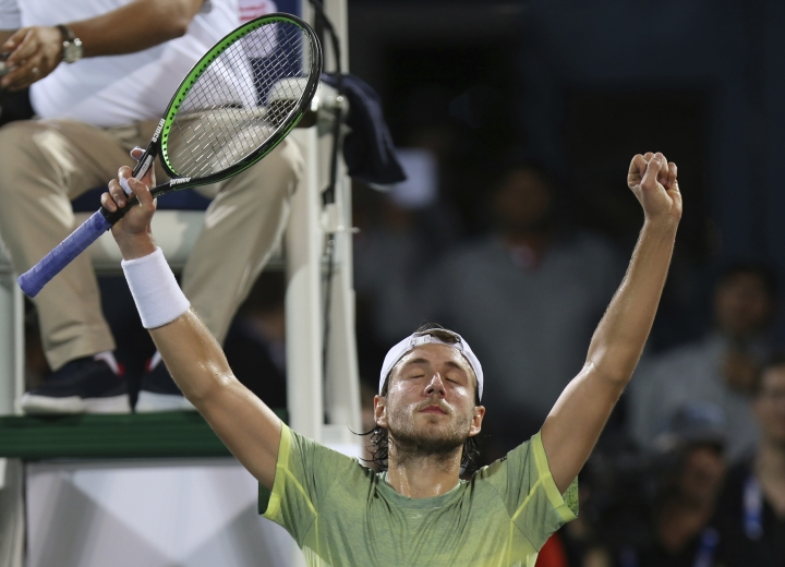 Lucas rouille of France celebrates after he beats Filip Krajinovic of Serbia during a semi final match of the Dubai Duty Free Tennis Championship in Dubai, United Arab Emirates, Friday, March 2, 2018. (AP Photo/Kamran Jebreili)