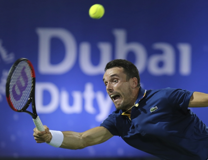 Roberto Batista Agut of Spain returns the ball to Malek Jaziri of Tunisia during a semi final match of the Dubai Duty Free Tennis Championship in Dubai, United Arab Emirates, Friday, March 2, 2018. (AP Photo/Kamran Jebreili)