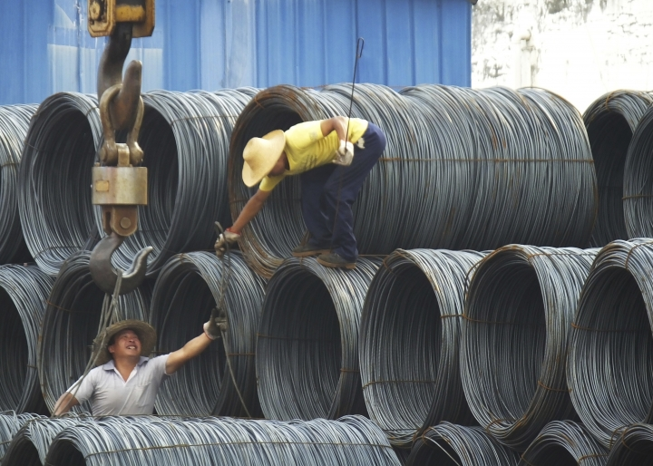 "In this Aug. 1, 2016 photo, laborers work in the steel market in Yichang in central China's Hubei province. China has expressed ""grave concern"" about a U.S. trade policy report that pledges to pressure Beijing but had no immediate response to President Donald Trump's plan to hike tariffs on steel and aluminum. The Commerce Ministry said Friday, March 2, 2018, that Beijing has satisfied its trade obligations and appealed to Washington to settle disputes through negotiation.(Chinatopix Via AP, File)"