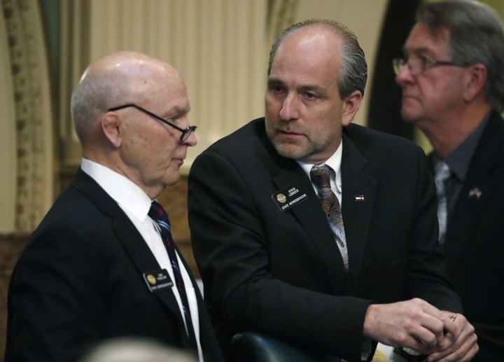 Colorado State Rep. Steve Lebsock, D-Thornton, right, chats with Rep. Dan Thurlow, R-Grand Junction, during a debate in the chamber whether to expel Lebsock over sexual misconduct allegations from his peers Friday, March 2, 2018, in the State Capitol in Denver. The effort faces tough odds amid Republican objections to how the complaints have been handled. (AP Photo/David Zalubowski)