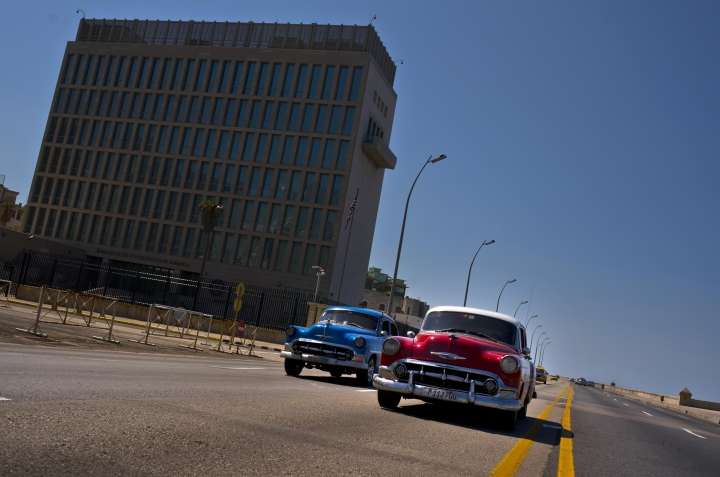 "Cars drive passt the United States Embassy in Havana, Cuba, Friday, March 2, 2018. Citing mysterious ""health attacks"" in Havana, the United States said Friday it was making permanent its withdrawal of 60 percent of its diplomats from Cuba as investigations continue. (AP Photo/Ramon Espinosa)"
