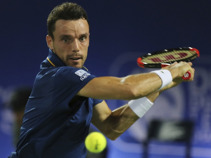 Roberto Batista Agut of Spain returns the ball to Malek Jaziri of Tunisia during a semi final match of the Dubai Duty Free Tennis Championship in Dubai, United Arab Emirates, Friday, March 2, 2018. (AP Photo/Kamran Jebreili)