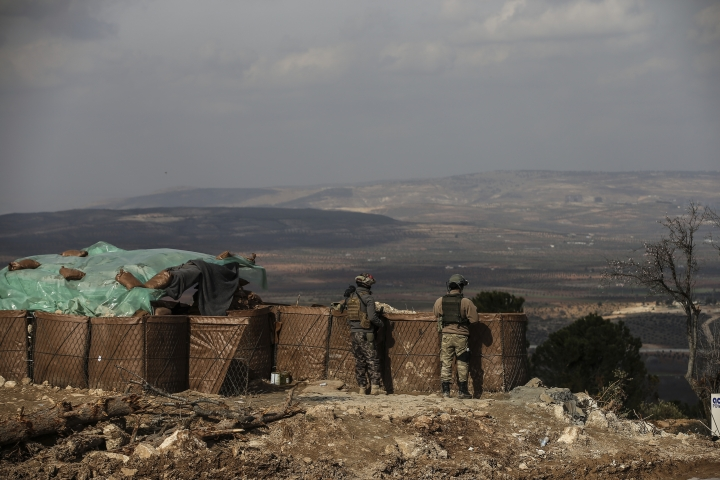 Turkish soldiers hold a position atop the Bursayah hill in the greater Afrin district, Syria, during a Turkish government-organised media tour into northern Syria, Saturday, March 3, 2018. Already in the sixth week of its offensive on the Kurdish-held enclave of Afrin in northwestern Syria, Turkey wants to oust the Syrian Kurdish People's Protection Units, or YPG, from Afrin. It considers the group an extension of a Kurdish insurgency within its own borders. (AP Photo/Emrah Gurel)