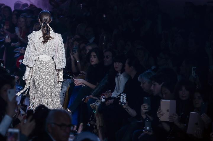 A model wears a creation for Elie Saab's ready-to-wear fall/winter 2018/2019 fashion week runway show in Paris, Saturday, March 3, 2018. (AP Photo/Kamil Zihnioglu)