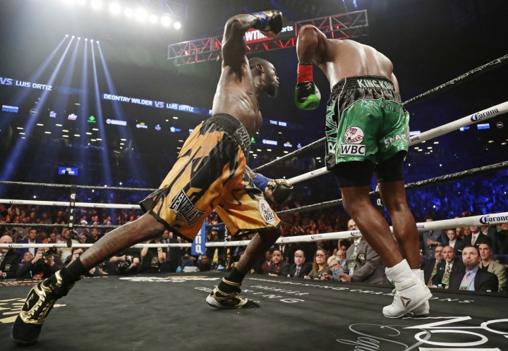 Deontay Wilder, left, punches Luis Ortiz during the 10th round of the WBC heavyweight championship bout Saturday, March 3, 2018, in New York. Wilder stopped Ortiz in the 10th round. (AP Photo/Frank Franklin II)