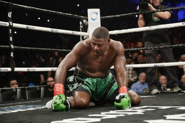 Luis Ortiz reacts after being knocked down by Deontay Wilder during the 10th round of the WBC heavyweight championship bout Saturday, March 3, 2018, in New York. Wilder stopped Ortiz in the 10th round. (AP Photo/Frank Franklin II)