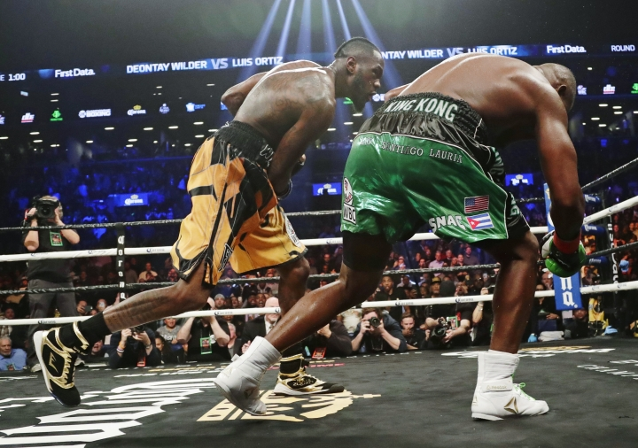 Deontay Wilder, left, follows through on a punch to Luis Ortiz during the 10th round of the WBC heavyweight championship bout Saturday, March 3, 2018, in New York. Wilder stopped Ortiz in the 10th round. (AP Photo/Frank Franklin II)