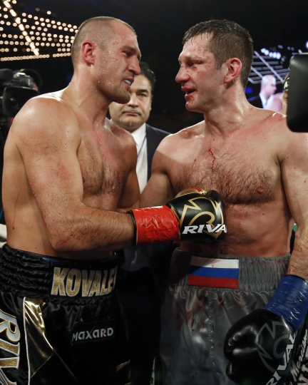Sergey Kovalev, left, talks with Igor Mikhalkin after their WBO light heavyweight title boxing match Saturday, March 3, 2018, in New York. Kovalev won the bout. (AP Photo/Adam Hunger)